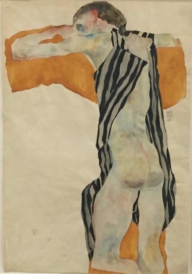 Egon Schiele, Liegender Mädchenakt in gestreiftem Kittel, 1911 - Privatsammlung Wien ©starkandart.com